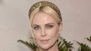 Charlize Theron Wears Custom Louis Vuitton Headband — Exclusive Interview